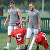 Ryan Fitzpatrick #14, New York Jets starting quarterback, right, and rookie quarterback #5 Christian Hackenberg head off the field after a day of team training camp at Atlantic Health Jets Training Center in Florham Park, NJ on Friday, Aug. 5, 2016