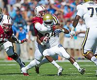 STANFORD, CA - October 19, 2013:  Stanford linebacker Shayne Skov (11) tackles the UCLA running back during the Stanford Cardinal vs the UCLA Bruins at Stanford Stadium in Stanford, CA. Final score Stanford Cardinal 24, UCLA Bruins  10.