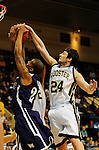 19 MAR 2011: Guard Justin Warnes  (24) of Wooster blocks the shot of hoop John Nance (44) of St. Thomas during the Division III Men's Basketball Championship held at the Salem Civic Center in Salem, VA. The University of St. Thomas (Minnesota) defeated College of Wooster 78-54 to win the national title.  Andres Alonso/NCAA Photos