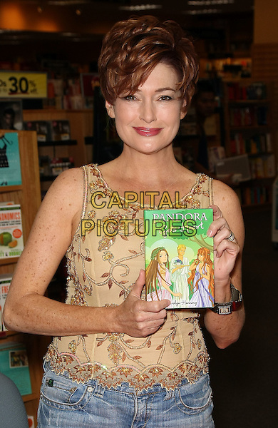 "CAROLYN HENNESY .Cougar Town Star and Daytime Emmy Nominee visits Las Vegas Borders Store for a Book Signing of ""Pandora Gets Heart"", Las Vegas, Nevada, USA, 26th June 2010..half length sleeveless gold brown patterned top vest  .CAP/ADM/MJT.© MJT/AdMedia/Capital Pictures."