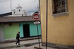 GUATEMALA  --  FEBRUARY 4, 2007:   A man walks in the street on February 4, 2007 in Nebaj, Guatemala.  (PHOTOGRAPH BY MICHAEL NAGLE)