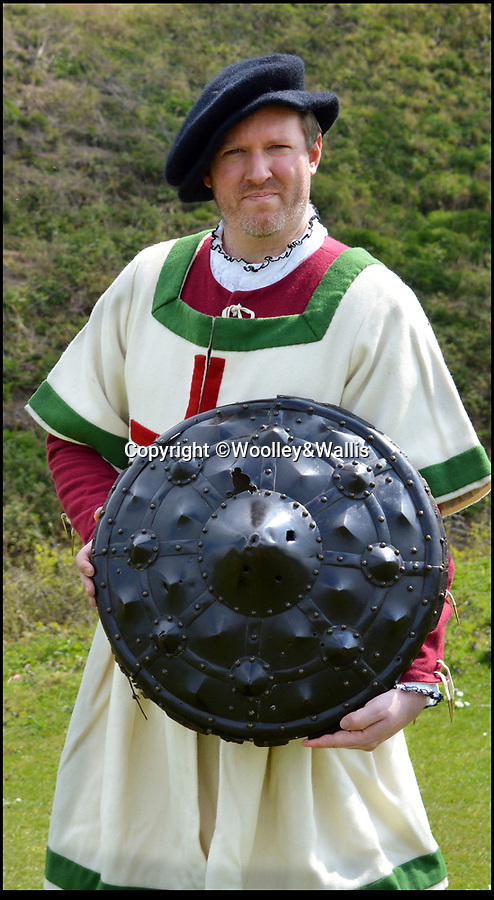 BNPS.co.uk (01202 558833)<br /> Pic: Wolley&Wallis/BNPS<br /> <br /> The Bodyguard - Tudor Style...<br /> <br /> An incredibly rare Tudor shield which has direct links to Henry VIII and his elite bodyguard has emerged for sale for £50,000.<br /> <br /> The historic 'gun shield' dates back to the 16th century and were thought to be used by Henry's personal bodyguard.<br /> <br /> An inventory of his armoury made shortly after his death lists only 35 of these specially designed defensive weapons that a matchlock pistol could be fired from.<br /> <br /> They have a specially designed hole in the centre that would have been used to poke the newly invented matchlock pistol through.
