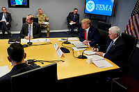 United States President Donald J. Trump, second from right, speaks during a teleconference with governors at the Federal Emergency Management Agency headquarters, Thursday, March 19, 2020, in Washington, DC.  At right is US Vice President Mike Pence and at left is US Secretary of Health and Human Services (HHS) Alex Azar.<br /> Credit: Evan Vucci / Pool via CNP/AdMedia