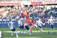 12th January 2020; Olympic Grande Torino Stadium, Turin, Piedmont, Italy; Serie A Football, Torino versus Bologna; Lukasz Skorupski, the goalkeeper of Bologna FC  punches the ball away from a cross under pressure from Lorenzo De Silvestri of Torino FC - Editorial Use