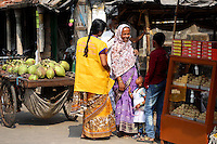 People talking in a small market in Kolkata.<br /> <br /> To license this image, please contact the National Geographic Creative Collection:<br /> <br /> Image ID: 1925786 <br />  <br /> Email: natgeocreative@ngs.org<br /> <br /> Telephone: 202 857 7537 / Toll Free 800 434 2244<br /> <br /> National Geographic Creative<br /> 1145 17th St NW, Washington DC 20036