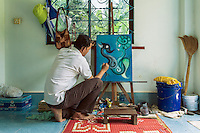 22/06/2012 - Battambang.Ot Veasna paints in the kitchen of his house just outside Battambang.