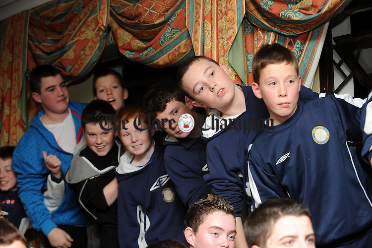Club members look on during the visit of Ray Houghton at the rebranding of Ennis Town Football Academy as Ennis Town Football Club in The Clare Inn Hotel. Photograph by John Kelly.