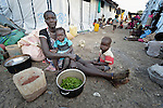 A newly displaced woman and her children inside a United Nations base in Malakal, South Sudan. More than 20,000 civilians have lived inside the base since shortly after the country's civil war broke out in December, 2013, but renewed fighting in 2015 drove another 5,000 people into the safety of the camp.