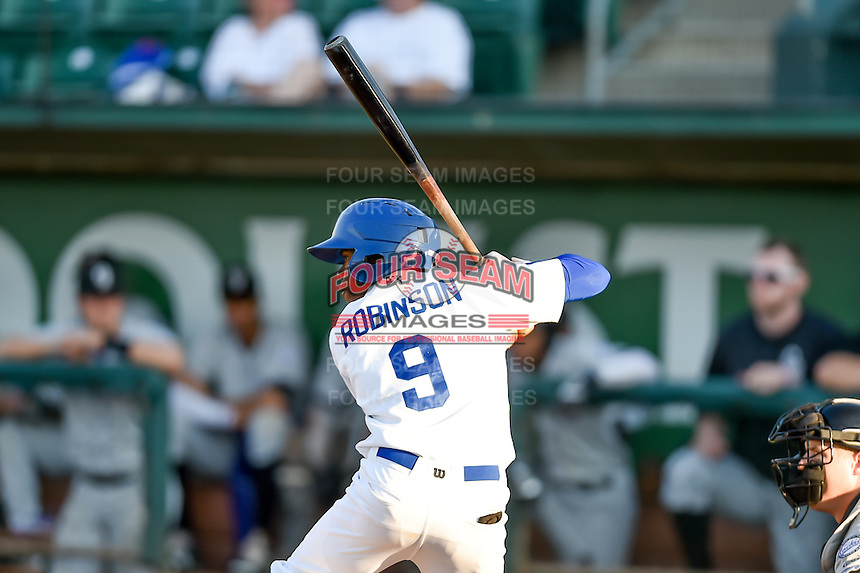 Errol Robinson (9) of the Ogden Raptors at bat against the Grand Junction Rockies in Pioneer League action at Lindquist Field on August 24, 2016 in Ogden, Utah. The Raptors defeated the Rockies 11-10. (Stephen Smith/Four Seam Images)