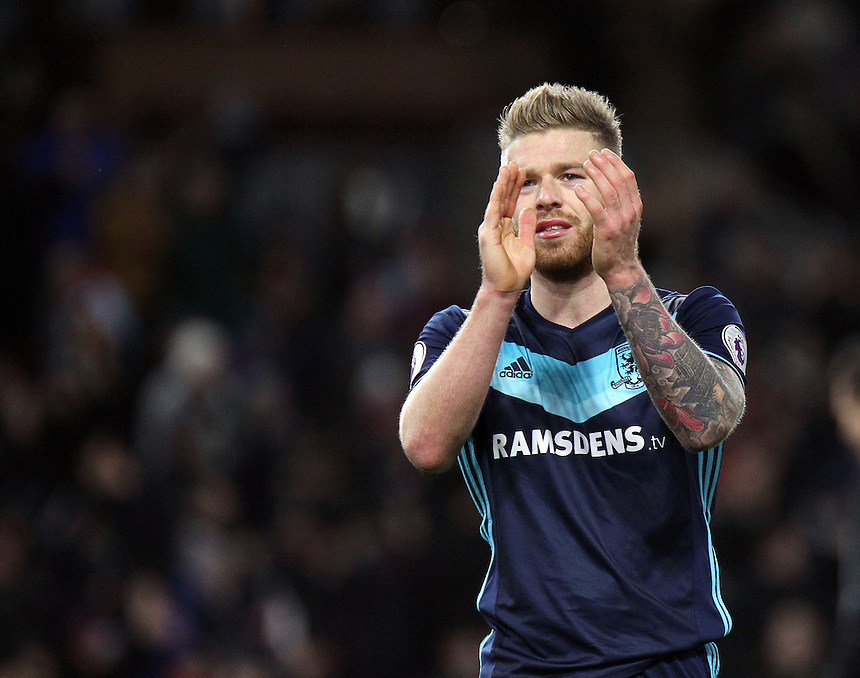Middlesbrough's Adam Clayton looks dejected as he applauds the travelling Middlesbrough fans at the final whistle<br /> <br /> Photographer Rich Linley/CameraSport<br /> <br /> The Premier League - Burnley v Middlesbrough - Monday 26th December 2016 - Turf Moor - Burnley<br /> <br /> World Copyright &copy; 2016 CameraSport. All rights reserved. 43 Linden Ave. Countesthorpe. Leicester. England. LE8 5PG - Tel: +44 (0) 116 277 4147 - admin@camerasport.com - www.camerasport.com