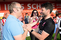 Lincoln City manager Danny Cowley, right, celebrates with a fan after winning the league<br /> <br /> Photographer Chris Vaughan/CameraSport<br /> <br /> The EFL Sky Bet League Two - Lincoln City v Tranmere Rovers - Monday 22nd April 2019 - Sincil Bank - Lincoln<br /> <br /> World Copyright © 2019 CameraSport. All rights reserved. 43 Linden Ave. Countesthorpe. Leicester. England. LE8 5PG - Tel: +44 (0) 116 277 4147 - admin@camerasport.com - www.camerasport.com