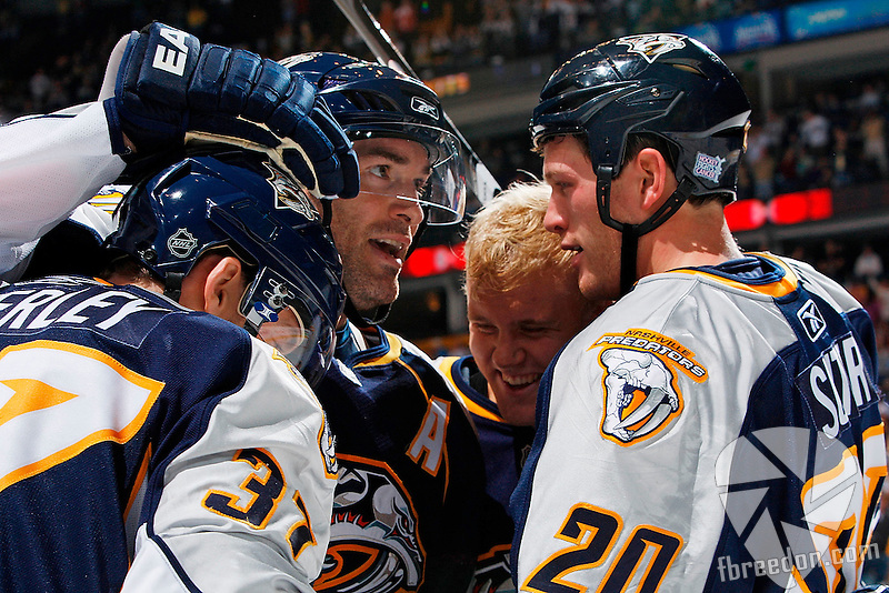 NASHVILLE, TN - OCTOBER 18:  (L-R) Center Rich Peverley #37 of the Nashville Predators is congratulated by teammates right wing J.P. Dumont #71, right wing Patric Hornqvist #27, and defenseman Ryan Suter #20 after scoring a goal against the Columbus Blue Jackets on October 18, 2008 at the Sommet Center in Nashville, Tennessee. The Predators defeated the Blue Jackets 6-3. (Photo by John Russell/NHLI via Getty Images) *** Local Caption *** Rich Peverley; J.P. Dumont; Patric Hornqvist; Ryan Suter