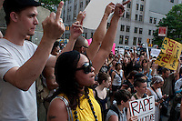 New York, NY -  27 May 2011 - A coalition of concerned New Yorkers, feminists, women's rights advocates, human rights advocates, gathered outside Manhattan Criminal Court at 100 Centre Street to protest the acquittal of two New York City police officers tried for rape.Kenneth Morreno and Franklin Mata were charged with raping a woman in 2008 but were acquitted of the more serious charge. However, the officers were found guilty of the much lesser charges of official misconduct. They are scheduled to be sentenced June 29 and could face up to two years in prison, though they might only get probation.
