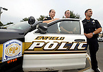 Three of the five new police officers on the Enfield Police Department, from left, Quannah Leonard, Matthew Alexander an Matthew Tarducci, Monday, Sept. 29, 2014, at the Enfield Public Safety Complex. (Jim Michaud / Journal Inquirer)