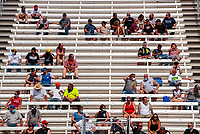 Jul 11, 2020; Clermont, Indiana, USA; NHRA fans social distance in the grandstands during qualifying for the E3 Spark Plugs Nationals at Lucas Oil Raceway. This is the first race back for NHRA since the start of the COVID-19 global pandemic. Mandatory Credit: Mark J. Rebilas-USA TODAY Sports