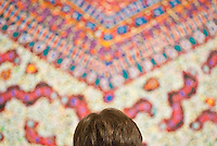 A guest studies a tapestry on the second floor during SAM Remix on Saturday, Nov. 13, 2010.