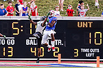 North Texas Mean Green defensive back Nate Brooks (9) and Southern Methodist Mustangs wide receiver Courtland Sutton (16) in action during the game between the North Texas Mean Green and the SMU Mustangs at the Gerald J. Ford Stadium in Fort Worth, Texas.