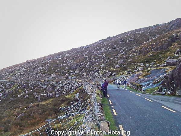 The two-way highway narrows to one lane as it climbs Connor Pass in County Kerry, Ireland.