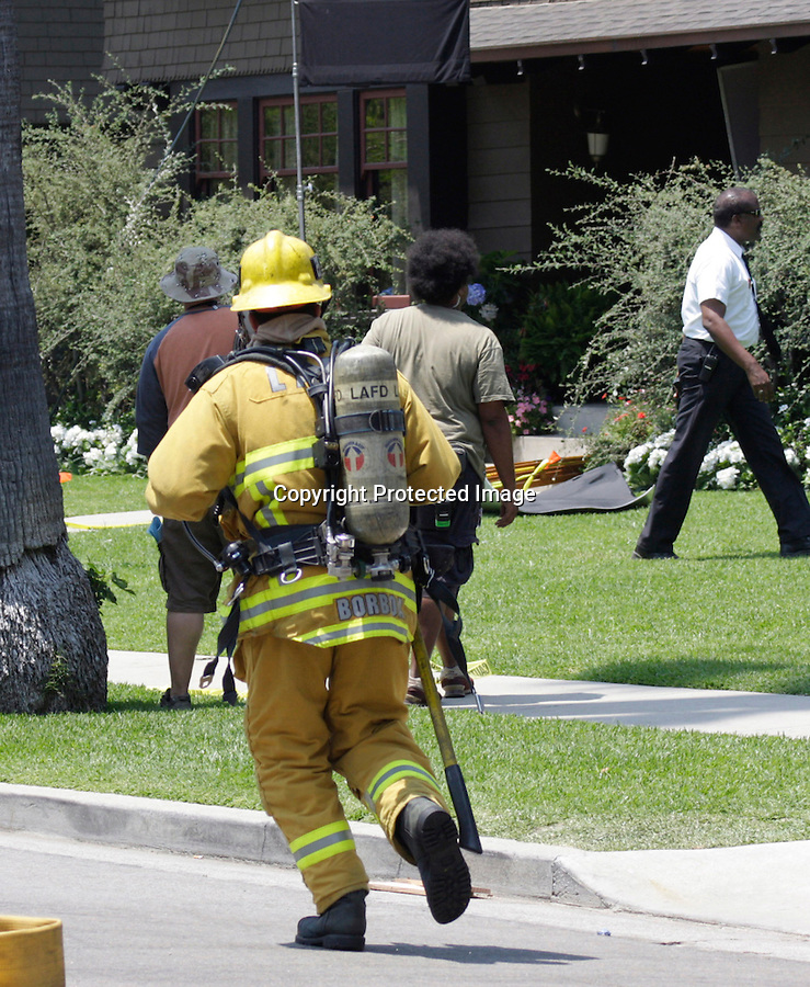 July 16th 2008  Exclusive .Shia Labeouf was filming a stunt scene for the new film Transformers 2 at a house in Los Angeles. The stunt went bad and the house caught on fire.  Shia ran outside and watched part of the house go up in flames. Fire Trucks arrived in only minutes and saved the house from total distruction. You might think Shia was wearing his flannel over his head because of all the smoke. Negative he just doesn't like to get his picture taken. He kept this up all day. ...www.AbilityFilms.com.805-427-3519.AbilityFilms@yahoo.com.