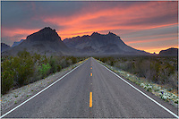 Looking at the Chisos Range from the east, I waited in the middle of the road for nearly 20 minutes for the skies to light up. The amazing thing was I never had to move because I did not encounter any cars. Along the road bloomed Big Bend bluebonnets and other Texas wildflowers. I was rewarded for my patience with a beautiful sunset in this Big Bend National Park image.