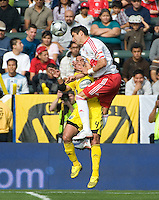 Juan Pablo Angel heads the ball over Gino Padula during MLS Cup 2008. Columbus Crew defeated the New York Red Bulls, 3-1, Sunday, November 23, 2008. Photo by John Todd/isiphotos.com