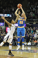 JAN 1, 2016:  UCLA's #20 Bryce Alford shoots a game tying three pointer while being guarded against Washington's #1 David Crisp.  Washington defeated #25 ranked UCLA 96-93 in double overtime at Alaska Airlines Arena in Seattle, WA.