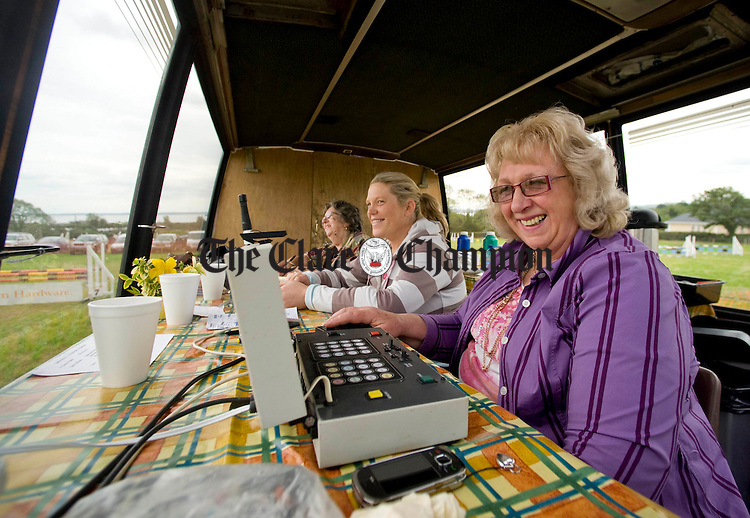 Mary Carey, Noelle Cobb and Mary Quinn, competition judges, watching events unfold at the Kildysart Show. Photograph by Declan Monaghan