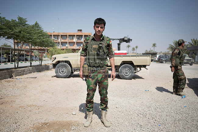 29/06/2014. Khanaqin, Iraq. A Kurdish peshmerga fighter stands for a portrait at a Kurdish peshmerga base in Khanaqin, Iraq. The peshmerga, roughly translated as those who fight, is at present engaged in fighting ISIS all along the borders of the relatively safe semi-automatous province of Iraqi-Kurdistan. Though a well organised and experienced fighting force they are currently facing ISIS insurgents armed with superior armament taken from the Iraqi Army after they retreated on several fronts. © Matt Cetti-Roberts