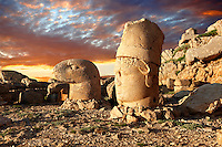 Pictures of the statues of around the tomb of Commagene King Antochus 1 on the top of Mount Nemrut, Turkey. Stock photos & Photo art prints. In 62 BC, King Antiochus I Theos of Commagene built on the mountain top a tomb-sanctuary flanked by huge statues (8–9 m/26–30 ft high) of himself, two lions, two eagles and various Greek, Armenian, and Iranian gods. The photos show the broken statues on the  2,134 m (7,001 ft)  mountain. 6