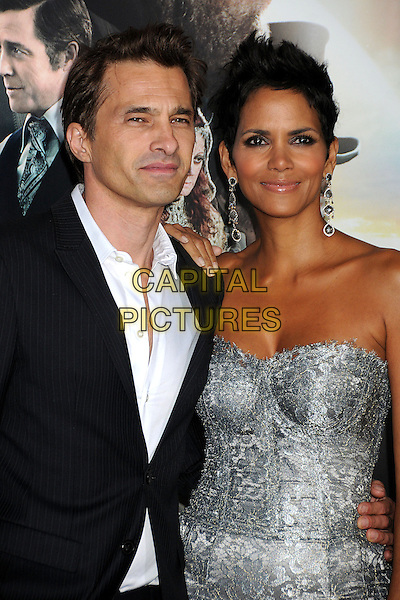 """Olivier Martinez & Halle Berry.""""Cloud Atlas"""" Los Angeles Premiere held at Grauman's Chinese Theatre, Hollywood, California, USA..October 24th, 2012.half length dress silver strapless lace white shirt black suit couple dangling earrings .CAP/ADM/BP.©Byron Purvis/AdMedia/Capital Pictures."""