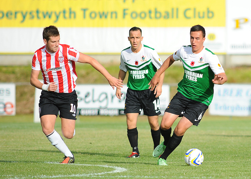 Aberystwyth Town's Thomas Atyeo under pressure from Derry City's Patrick McEleney<br /> <br /> Photographer Kevin Barnes/CameraSport<br /> <br /> Europa League - First Qualifying Round - Second Leg - Aberystwyth Town v Derry City - Thursday 10th July 2014 - Park Avenue - Aberystwyth<br /> <br /> &copy; CameraSport - 43 Linden Ave. Countesthorpe. Leicester. England. LE8 5PG - Tel: +44 (0) 116 277 4147 - admin@camerasport.com - www.camerasport.com