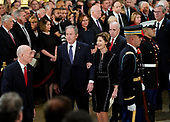 Former President George W. Bush, former first lady Laura Bush walk past leaders of Congress after attending ceremonies for former President George H.W. Bush in the Capitol Rotunda, Monday, Dec. 3, 2018 in Washington. (AP Photo/Pablo Martinez Monsivais/Pool)