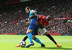 Henrikh Mikhitaryan of Arsenal tackled by Ashley Young of Manchester United during the premier league match at the Old Trafford Stadium, Manchester. Picture date 29th April 2018. Picture credit should read: Simon Bellis/Sportimage