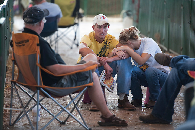 UNITED STATES - AUGUST 12:  Livestock competitors take a break near the animal pens at the Iowa State Fair in Des Moines, Iowa.  (Photo By Tom Williams/Roll Call)