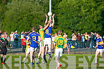 Glenflesk's Eric O'Donoghue and Finuge's John Mc Carthy compete for this kick-out in the Intermediate Club Championship Quarter-final in Glenflesk last Saturday.