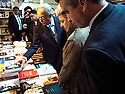 Iraq 2013 .The opening of the Book Fair in Erbil with the President Masoud Barzani : looking at books in a stand    .Irak 2013 .Ouverture du salon du livre a Erbil par le président Masoud Barzani: coup d'oeil sur des livres dans un stand