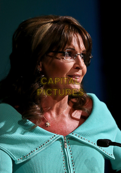 Sarah Palin.Women's Resource Medical Centers of Southern Nevada Hosts 28th Annual Shareholders in Life Banquet & Silent Auction Featuring Keynote Speech from Governor Sarah Palin at The Rio, Las Vegas, NV, USA, 26th April 2013..portrait headshot  jacket suit speaking microphone profile  green glasses .CAP/ADM/MJT.© MJT/AdMedia/Capital Pictures