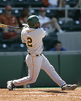 Baylor CF Paul Miles (2) follows through against Texas on May 3rd, 2008. Photo by Andrew Woolley / Four Seam Images