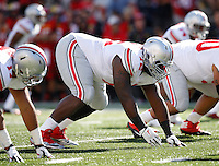 Ohio State Buckeyes defensive lineman Chris Carter (72) takes his stance at the line of scrimmage during the Buckeyes' 52-24 win over the Maryland Terrapins in the NCAA football game at Byrd Stadium in College Park, Maryland on Oct. 4, 2014. (Adam Cairns / The Columbus Dispatch)