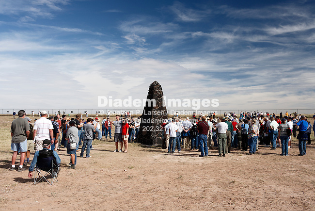 Sightseers gather around the obelisk marking the site of the world's first atomic explosion, July 16, 1945.  Trinity Site is located in New Mexico on the White Sands Missile Range.  (Photograph by Jonathan P. Larsen)