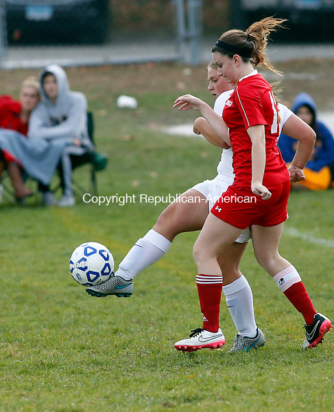 Winsted, CT- 27 October 2015-102715CM04- Wamogo's Kristen Kandefer, right goes after the ball as Gilbert's Jillian Wexler sends it up field during their soccer matchup in Winsted on Tuesday.     Christopher Massa Republican-American