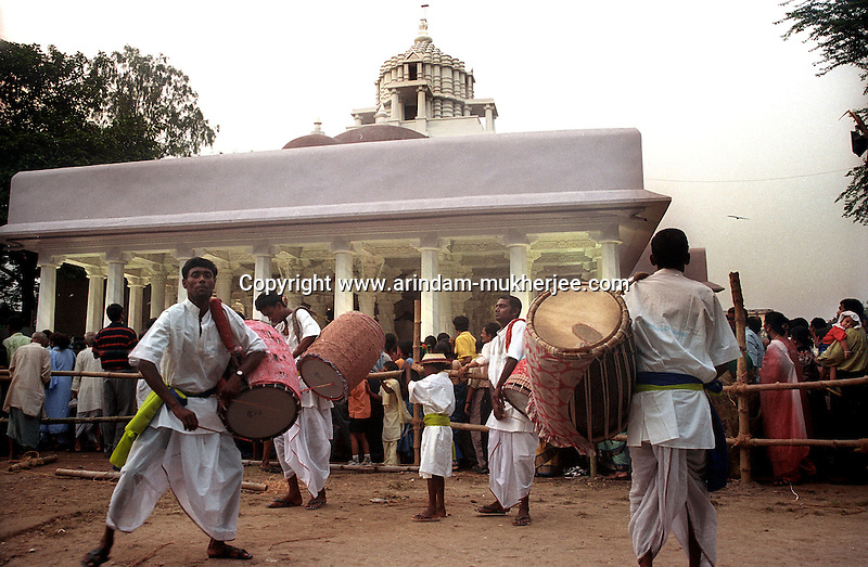 INDIA (West Bengal - Calcutta)  2006, Drummers dancing in their own rythm as the pandal hopping crowd lined up to see the idol and the decoration of the pandal in one of the famous pandals at JNodhpur Park in South Calcutta. Durga Puja Festival is the biggest festival among bengalies.  As Calcutta is the capital of West Bengal and cultural hub of  the bengali community Durga puja is held with the maximum pomp and vigour. Ritualistic worship, food, drink, new clothes, visiting friends and relatives places and merryment is a part of it. In this festival the hindus worship a ten handed godess riding on a lion armed wth all possible deadly ancient weapons along with her 4 children (Ganesha - God for sucess, Saraswati - Goddess for arts and education, Laxmi - Goddess of wealth and prosperity, Kartikeya - The god of manly hood and beauty). Durga is symbolised as the women power in Indian Mythology.  In Calcutta people from all the religions enjoy these four days of festival in the moth of October. Now the religious festival has become the biggest cultural extravagenza of Calcutta the cultural capital of India. Artistry and craftsmanship can be seen in different sizes and shapes in form of the idol, the interior decor and as well as the pandals erected on the streets, roads and  parks.- Arindam Mukherjee
