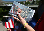 Denise Real holds a photo of her daughter Nekah Dmitrieva at the start of a Veterans Suicide Awareness walk in Carson City, Nev., on Saturday, May 2, 2015. Hosted by the Western Nevada College Veterans Resource Center, the event raises awareness of the more than 8,000 veteran suicides each year in the U.S. <br /> Photo by Cathleen Allison