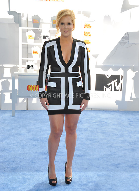 WWW.ACEPIXS.COM<br /> <br /> April 12 2015, LA<br /> <br /> Amy Schumer arriving at the 2015 MTV Movie Awards at the Nokia Theatre L.A. Live on April 12, 2015 in Los Angeles, California.<br /> <br /> By Line: Peter West/ACE Pictures<br /> <br /> <br /> ACE Pictures, Inc.<br /> tel: 646 769 0430<br /> Email: info@acepixs.com<br /> www.acepixs.com