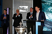 Champion Scott Dixon with Mark Miles and Jay Frye