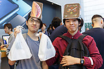 Satisfied buyers pose for a photograph after buying the new iPhone XS or iPhone XS Max at the Apple Store in Omotesando on September 21, 2018, Tokyo, Japan. Apple fans lined up patiently in the early morning rain to get the new iPhone models (XS and XS Max) and the new iWatch (Series 4). The new iPhone XS costs JPY 112,800 for the 64 GB model, the iPhone XS Max costs JPY 124,800 JPY for the 64 GB model, and iWatch Series 4 costs JPY 45,800. (Photo by Rodrigo Reyes Marin/AFLO)
