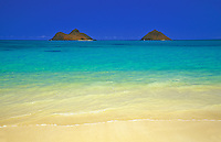 A view of the Mokulua Islands from Lanikai beach, on the Windward side of Oahu; the islands are part of the Hawaii State Seabird Sanctuary