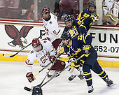 Michael Sit (BC - 18), Zach Sanford (BC - 24), John Gustafsson (Merrimack - 28), Dan Kolomatis (Merrimack - 26), Mathieu Tibbet (Merrimack - 22) - The Boston College Eagles defeated the visiting Merrimack College Warriors 2-1 on Wednesday, January 21, 2015, at Kelley Rink in Conte Forum in Chestnut Hill, Massachusetts.