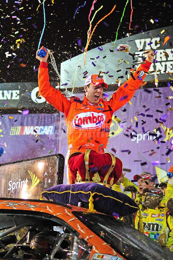 May 2, 2009; Richmond, VA, USA; NASCAR Sprint Cup Series driver Kyle Busch celebrates after winning the Russ Friedman 400 at the Richmond International Raceway. Mandatory Credit: Mark J. Rebilas-