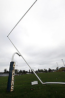 Photo By Chris Mackler: The marred goalpost sits slanted at Basil Rutter Field at Athens High School in The Plains, Ohio, on the morning of Friday, Sept. 17, 2010. An unconfirmed tornado ripped through The Plains, Ohio Thursday Sept. 16, 2010, causing downed power lines, uprooted trees, overturned mobile homes and significant damage to Athens High School.